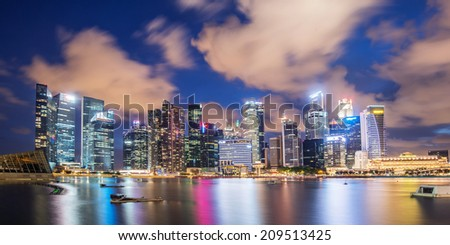 SINGAPORE - 19 May, 2014: Marina Bay central business district in Singapore. Late evening panorama of popular tourist area in downtown of city. Merlion statue in the front is the symbol of Singapore - stock photo