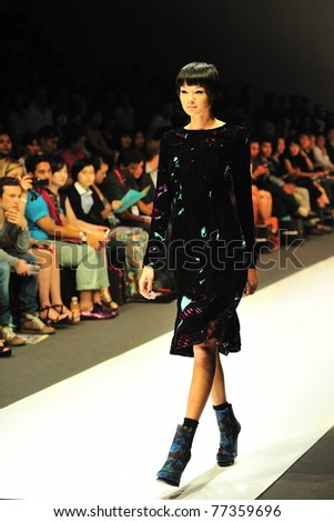 SINGAPORE - MAY 14: Model walks down the runway, showcasing designs by Erdem Moralioglu at Audi Fashion Festival 2011 Erdem Show on May 14, 2011 in Singapore.