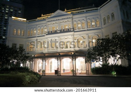SINGAPORE - 26 May, 2014:Raffles Hotel Singapore by night. Raffles Hotel is a colonial style hotel currently managed by Fairmont Raffles Hotel International.  - stock photo