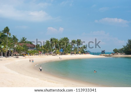 SINGAPORE - MAY 3: Sentosa is a popular island resort in Singapore, with attractions that  include a 2 km long sheltered beach. May 3, 2011 in Singapore, Singapore. - stock photo