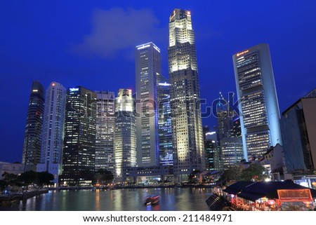 SINGAPORE - 27 May, 2014:Singapore skyline by night. Singapore plays important role as an economic, financial and business centre of South East Asia.