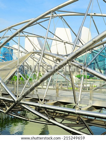 SINGAPORE - MAY 09,2103: The Helix Bridge in Singapore. Is a bridge in the Marina Bay. The Helix is fabricated from 650 tonnes of Duplex Stainless Steel and 1000 tonnes of carbon steel. - stock photo
