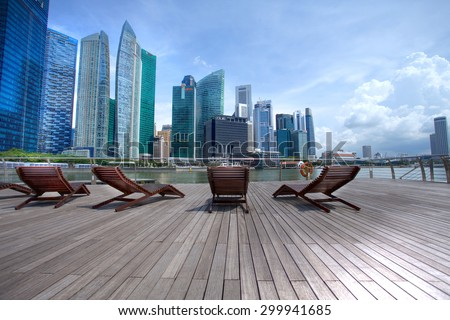 SINGAPORE-MAY 9: The Marina Bay Sands Resort Hotel on May 9, 2015 in Singapore. It is an integrated resort and the world's most expensive standalone casino property at S$8 billion. - stock photo