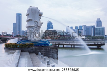 SINGAPORE, MAY 23:The Merlion fountain and Marina Bay Sands, famous touristic attractions of Singapore, on May 23, 2015 in Singapore - stock photo