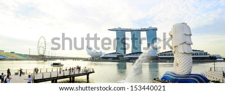 SINGAPORE - MAY 09: The Merlion fountain in front of the Marina Bay Sands hotel on May 09, 2013 in Singapore. Merlion is a imaginary creature with the head of a lion, seen as a symbol of Singapore