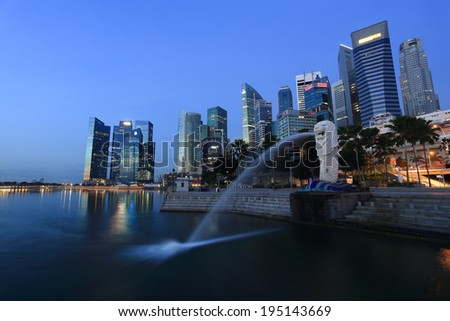 SINGAPORE - May 10: The Merlion fountain in front of the Marina Bay Sands hotel on May 10, 2014 in Singapore. Merlion is a imaginary creature with the head of a lion, seen as a symbol of Singapore - stock photo