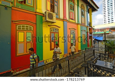 SINGAPORE- MAY 1: Unidentified people around Colorful facade of building in Little India on May 1, 2012 in Singapore. - stock photo