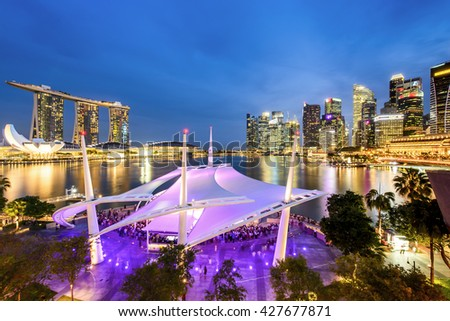 SINGAPORE - MAY 21: View of Marina Bay Sands on May 21, 2016 taken from roof top of Esplanade in Singapore. Marina Bay Sands is the resort and the world's most expensive standalone casino property. - stock photo