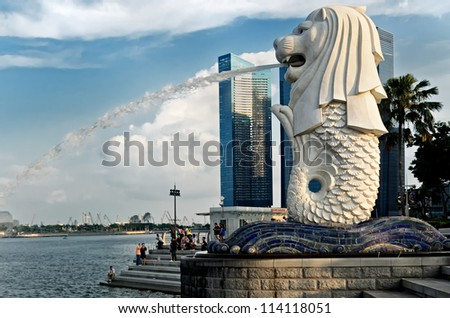 SINGAPORE - MAY 11: View of Merlion Statue on May 11, 2012 in Singapore. A mythical creature with the head of a lion and the body of a fish, used as a mascot and national personification of Singapore. - stock photo