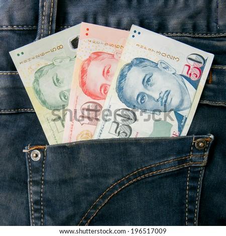 Singapore money  bill in jean pocket - stock photo