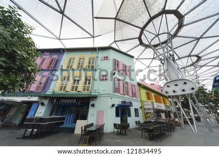 SINGAPORE - NOV 04 : Clarke Quay on Nov 04, 2012 in Singapore. Clarke Quay, a mecca for tourists, is a historical riverside quay in Singapore, located within the Singapore River Planning Area. - stock photo