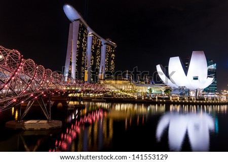 SINGAPORE - NOV 5 : Front view of the Marina Bay Sands Resort at the mouth of the Singapore River on Nov 5th, 2011 in Singapore. This waterfront resort and casino is a tourist attraction. - stock photo