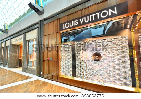 SINGAPORE -NOV18: Louis Vuitton Store in Marina Bay Sands Shopping mall, Singapore on November18, 2015. LV has been named the world's most valuable luxury brand.Its 2012 valuation was 25.9 billion USD - stock photo