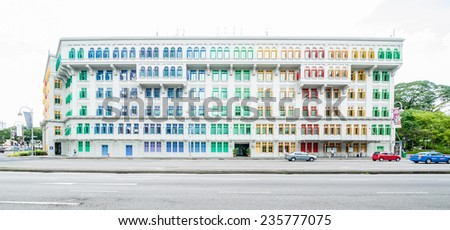 SINGAPORE - NOV 25: MICA building on November 25, 2014 in Singapore. It was known as the Old Hill Street Police Station. This building has a total of 927 windows and are painted in the rainbow color. - stock photo