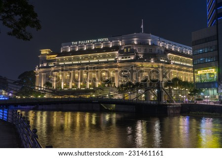 SINGAPORE - NOV 3 : The Fullerton Hotel on November 3rd, 2014 in Singapore.The hotel was named after Robert Fullerton,the first Governor in 1919 as part of the British colony's centennial celebrations - stock photo