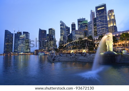 SINGAPORE-NOV 11: The Merlion fountain and Singapore skyline on Nov 11, 2011. Merlion is an imaginary creature with a head of a lion and the body of a fish and is often seen as a symbol of Singapore - stock photo