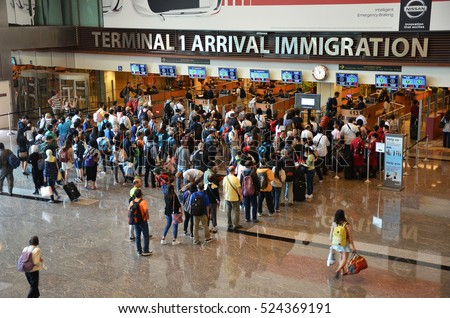 SINGAPORE - 18 NOV, 2016: Travelers enter immigration control at Changi International Airport in Singapore.
