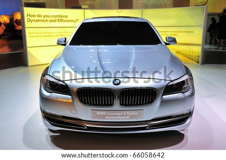 SINGAPORE - NOVEMBER 14: BMW Concept 5 Series ActiveHybrid at BMW World Singapore 2010 at Marina Bay Sands Expo on November 14, 2010 in Singapore - stock photo