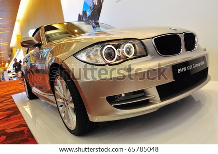 SINGAPORE - NOVEMBER 14: BMW 120i Convertible at BMW World Singapore 2010 at Marina Bay Sands Expo November 14, 2010 in Singapore - stock photo