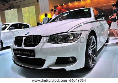 SINGAPORE - NOVEMBER 14: BMW 335i coupe at BMW World Singapore 2010 at Marina Bay Sands Expo November 14, 2010 in Singapore - stock photo