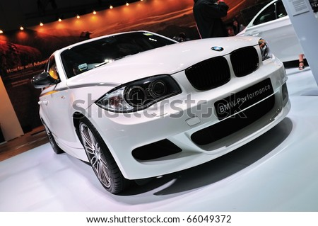 SINGAPORE - NOVEMBER 14: BMW 120i hatchback at BMW World Singapore 2010 at Marina Bay Sands Expo November 14, 2010 in Singapore - stock photo