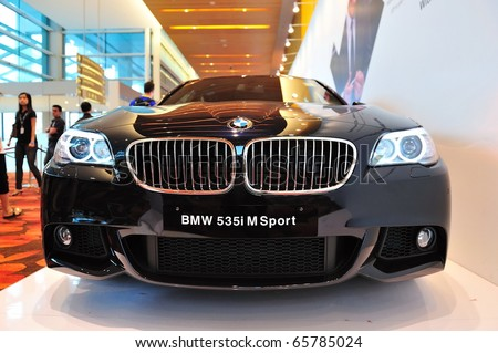 SINGAPORE - NOVEMBER 14: BMW 535i M Sport Sedan at BMW World Singapore 2010 at Marina Bay Sands Expo November 14, 2010 in Singapore - stock photo