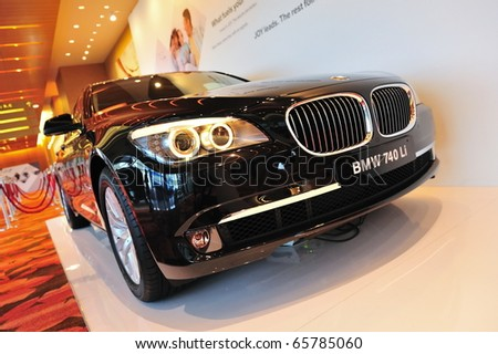 SINGAPORE - NOVEMBER 14: BMW 740 Li Sedan at BMW World Singapore 2010 at Marina Bay Sands Expo November 14, 2010 in Singapore - stock photo