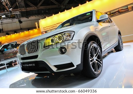 SINGAPORE - NOVEMBER 14: BMW X3 sports utility vehicle at BMW World Singapore 2010 at Marina Bay Sands Expo November 14, 2010 in Singapore - stock photo