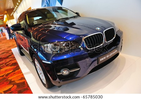 SINGAPORE - NOVEMBER 14: BMW X6 xDrive35i sports activity coupe at BMW World Singapore 2010 at Marina Bay Sands Expo November 14, 2010 in Singapore - stock photo