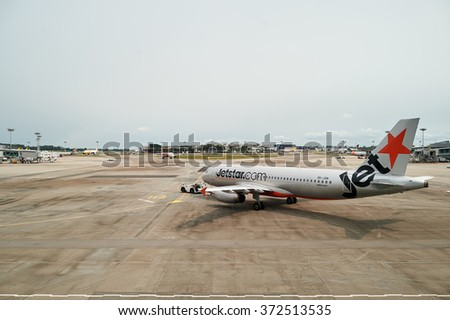 SINGAPORE - NOVEMBER 04, 2015: Jetstar aircraft in Singapore Changi Airport. Jetstar Airways Pty Ltd, trading as Jetstar, is an Australian low-cost airline headquartered in Melbourne, Australia.