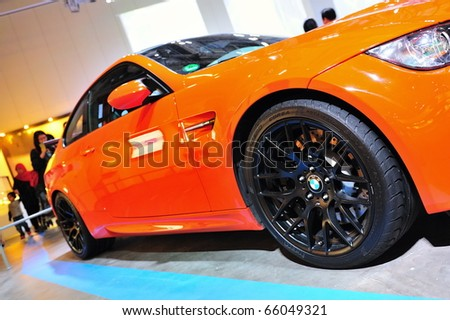 SINGAPORE - NOVEMBER 14: Orange BMW M3 GTS at BMW World Singapore 2010 at Marina Bay Sands Expo November 14, 2010 in Singapore - stock photo