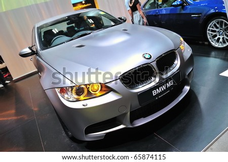 SINGAPORE - NOVEMBER 14: Silver BMW M3 Sedan at BMW World Singapore 2010 at Marina Bay Sands Expo November 14, 2010 in Singapore - stock photo