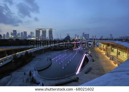 SINGAPORE - NOVEMBER 21: Singapore Marina Barrage against skyline at night November 21, 2010 in Singapore. - stock photo