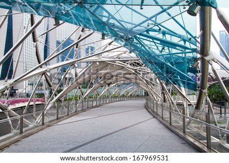 SINGAPORE - NOVEMBER 14: The Helix Bridge on November 14, 2013 in Singapore. Is a pedestrian bridge linking Marina Centre with Marina South in the Marina Bay. - stock photo
