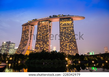 SINGAPORE-NOVEMBER 1: The Marina Bay Sands Resort Hotel in twilight time on November 1, 2014 in Singapore. It is an integrated resort and the world's most expensive standalone casino.   - stock photo