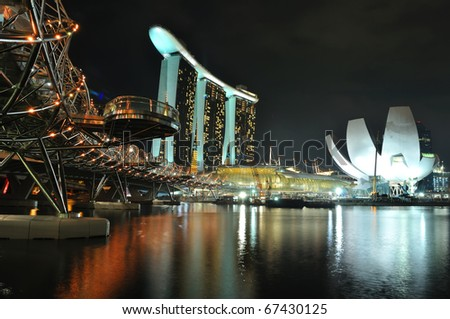 SINGAPORE - NOVEMBER 13:The Marina Bay Sands Resort stands majestically at the mouth of the Singapore River November 13, 2010 in Singapore. This waterfront resort and casino is a tourist attraction. - stock photo