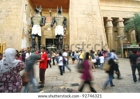 SINGAPORE - November 27: Visitors walking at the Ancient Egypt on November 27, 2011 in Singapore. Ancient Egypt it is part of themed zone at the Universal Studios Singapore theme park. - stock photo
