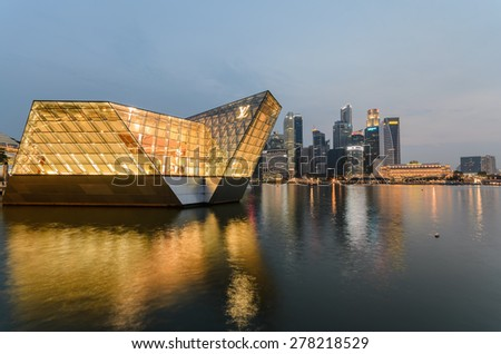 SINGAPORE-OCT 4 : Colorful light building at night in Singapore. - stock photo