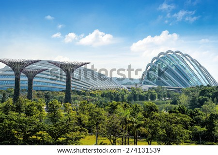 SINGAPORE - OCT 25: Day view of The Supertree Grove at Gardens by the Bay on Oct 25, 2014 in Singapore. Spanning 101 hectares, and five-minute walk from Bayfront MRT Station.  - stock photo