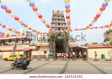 SINGAPORE -OCT 12: Facade of Sri Mariamman Hindu temple on Oct 12, 2012 in Singapore -one of the most colorful ethnic areas and popular among tourists visiting Singapore from around the world. - stock photo