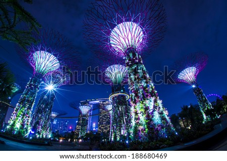 SINGAPORE - OCT 13: Night view of The Supertree Grove at Gardens by the Bay on Oct 13, 2012 in Singapore. Spanning 101 hectares, and five-minute walk from Bayfront MRT Station.  - stock photo
