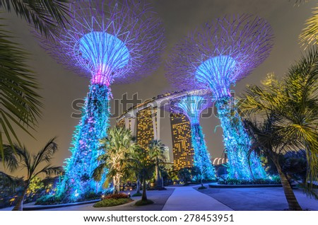 SINGAPORE-OCT 6 : Night view of The Supertree Grove at Gardens by the Bay on October 6, 2015 in Singapore. Spanning 101 hectares, and five-minute walk from Bayfront MRT Station. - stock photo