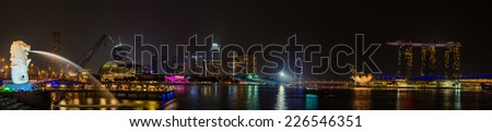SINGAPORE - OCT 18, 2014: Panorama of The Merlion park. the Marina Bay Sands hotel on Oct 18, 2014 in Singapore. Merlion is a imaginary creature with the head of a lion, seen as a symbol of Singapore.