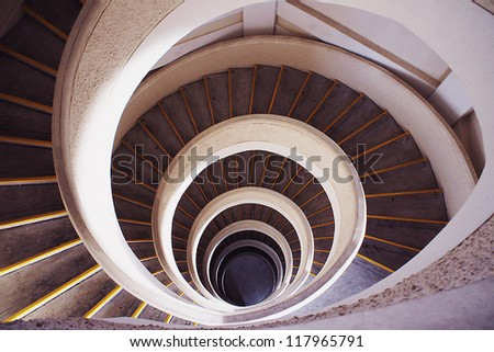 SINGAPORE - OCT 20: Spiral Staircase in a Pagoda at Chinese Garden on Oct 20, 2012 in Singapore. Chinese Garden is a park in Jurong East, Singapore, with a 7-story pagoda situated on a small hill.