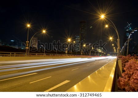 Singapore,Oct 15th,2014:View Car lights at night in Singapore city.