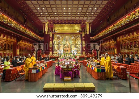 SINGAPORE - OCTOBER 16, 2014: Buddha Tooth Relic Temple interior. Its a main Buddhist temple in the Chinatown district of Singapore.