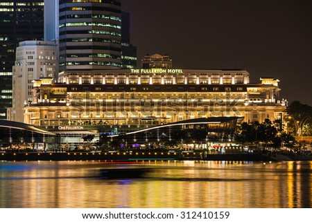 SINGAPORE - OCTOBER 16, 2014: The Fullerton Hotel Singapore is a five star luxury hotel located near the mouth of the Singapore River, in the 