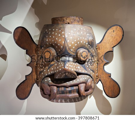 SINGAPORE - OCTOBER 15, 2014: Tribal mask in the Asian Civilisations Museum in Singapore.