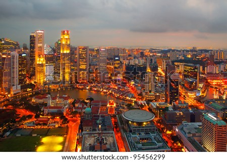 Singapore on a winter evening (Evening artificial lighting in the city) - stock photo