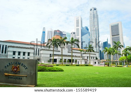 Singapore Parliament builading in front of Singapore downtown - stock photo